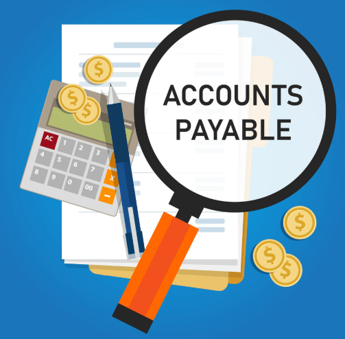A lens that contains the text 'accounts payable' along with a calculator, a few dollars, pen and a account statement sheet that every virtual accountant has.