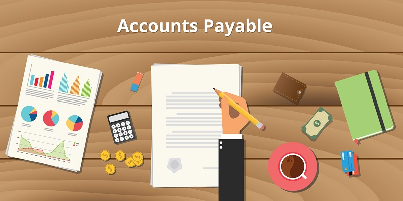 An illustration of accounts payable with bar chart, line chart, pie chart all displayed in one analysis sheet, dollar in coins and notes, a calculator, eraser, a hand holding pencil evaluating the accounting sheet, ATM cards, a wallet, a diary and a cup of brewed drink.